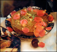 Swedish cardamom cake with the Parsi touches of rose petals and edible gold leaves.