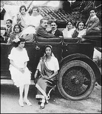 Niloufer's mother, Shireen Ichaporia, on the running board of her paternal uncle's car.