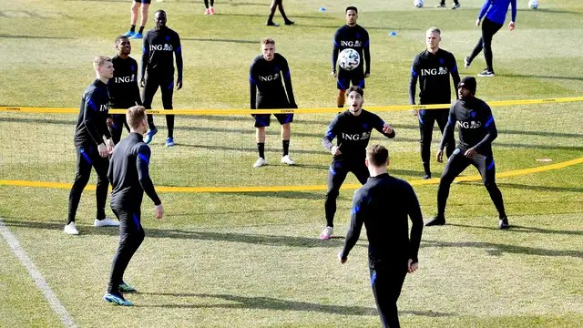 The players of the Dutch Juniors play a game of foot volley during practice.