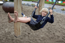 Lucien Perez, 7, is helping his body and brain to develop as he enjoys some unstructured play time on the swing at Wynyard Quarter in Auckland.  Photo / Sarah Ivey