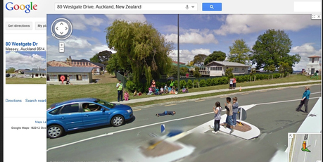A Google Streetview image of Westgate Drive Auckland showing a child lying in the road during a what is described as a road safety drill. Photo / Supplied