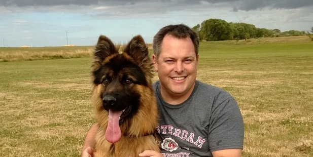 Steve Glassey, with his dog Diesel.