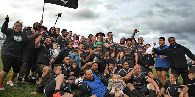 AT LONG LAST: The Pirates and their supporters celebrate winning the 2014 Tasman Tanning Premier final over Ruapehu on Saturday.PHOTO/BEVAN CONLEY 020814WCBRCRUG15
