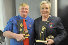Husband-and-wife Blue and Angela Hansen display their awards.