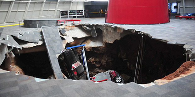 Several cars that collapsed into a sinkhole in Bowling Green, Kentucky, in February 2014. Photo / National Corvette Museum/AP