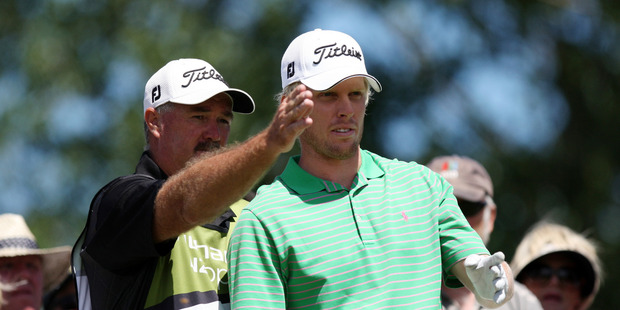 Andrew Dodt, Australia, rigt and his caddy talk tactics. Photo / Dianne Mason.