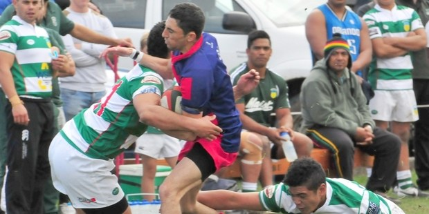 COVERED: Pioneer halfback Joseph Thompson is sandwiched between two Marist defenders in the Tui Cup Match played at Memorial Park last Saturday. PHOTO/CHRIS KILFORD
