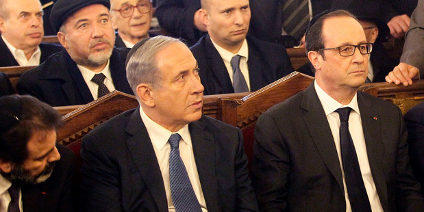 Francois Hollande reported left this ceremony at the Grand Synagogue in Paris as Israel's Prime Minister Netanyahu got up to speak. Photo / AP