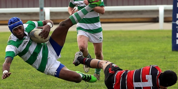 FULL VELOCITY: Marist fullback Simeli Koniferdi comes down after contact with Taihape flanker Timi Teepa in their upset victory at Spriggens Park on Saturday. PHOTOS/STUART MUNRO