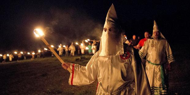 "Ku Klux Klan members participate in cross burnings after a ""White Pride,"" rally, in rural Paulding County, Georgia. Photo / AP"