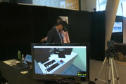 Liam Dann testing out new VR tech at the Singularity event.