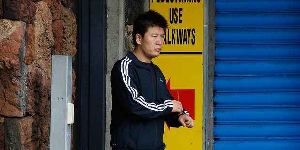Yong Ming Yan leaves the Auckland Central Police Station after a bail check. Photo / Greg Bowker.