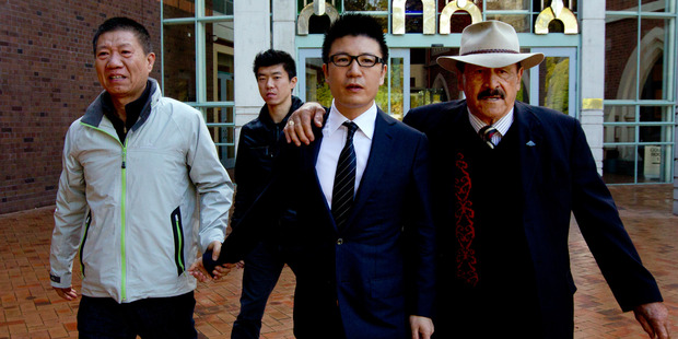 William Yan outside the High Court during his 2012 with Dover Samuels, former Labour MP. Photo / Brett Phibbs.