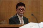 Millionaire businessman William Yan, also known as Bill Liu and Yong Ming Yan, being sentenced at the Auckland District Court today for money laundering. Photo / Brett Phibbs