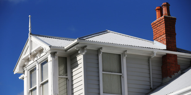 The New Zealand housing market is cooling faster than expected and could take some pressure off bank funding costs. Photo / Doug Sherring