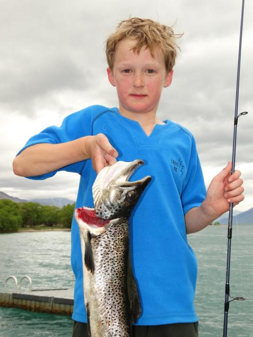 Overall Junior-Child Trophy winner Seamus Hickey (11) shows off his 1.59kg brown trout. Photo / Guy Williams