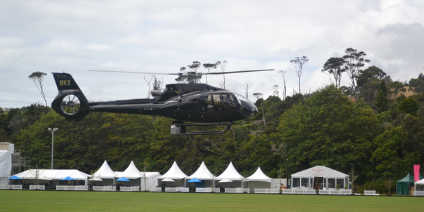 NZ Polo Open organisers bring in the choppers to dry out the field at Clevedon. Photo / Anna Hood