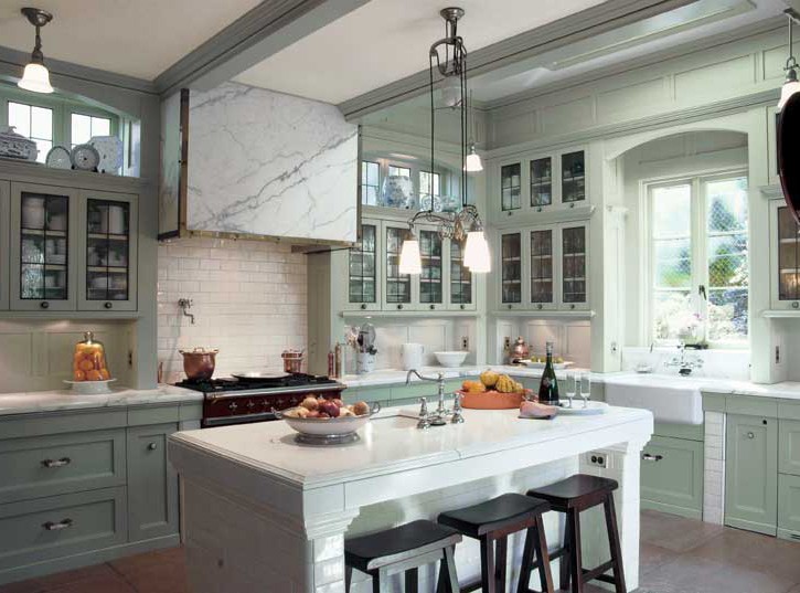 Refrigerator, sink and range form the work triangle, while the island functions as a prep area.