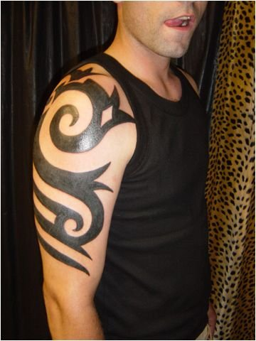 Placement of Tribal Armband Tattoos always goes on the arm by nature.