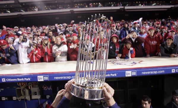 Phillies carry the 2008 World Series trophy back to the club house in front of fans at Citizens Bank Park on Wednesday, October 29, 2008.  ( Michael Perez  / Staff Photographer )