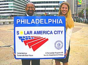 Kristin Sullivan (right) joins Mayor Nutter in promoting solar incentives.