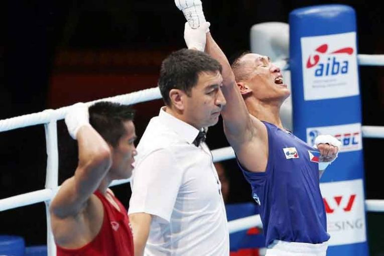 Boxing Philippines last golden hope   Philstar com Filipino Rogen Ladon  right  lets out a big yell as the referee raises his  arm for his win over Thai Tongdee Yuttapong in the men s 52kg semifinals of  the