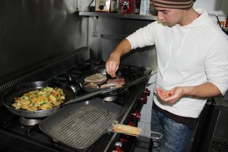 Daniel learning to cook at Central Vila Restaurant in Carvalhal
