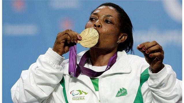 Esther Onyema kisses her medal