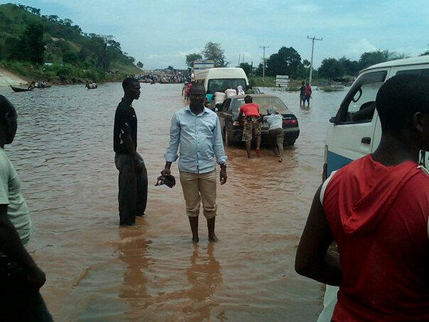 Lokoja, the Kogi State capital, houses are flooded and cars submerged