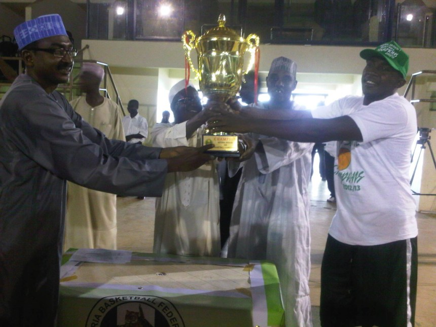 NBBF President, Tijani Umar presenting the Trophy to the Captain of Plateau Peaks