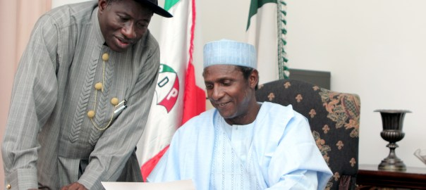 Late Umaru Musa Yar'Adua (sitting) with Former President Goodluck Jonathan in party office