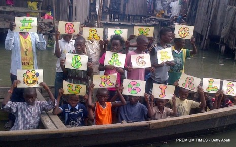 Youngsters in the waterside community in Makoko, Lagos joinging in the global cry to BringBackOurGirls Photo