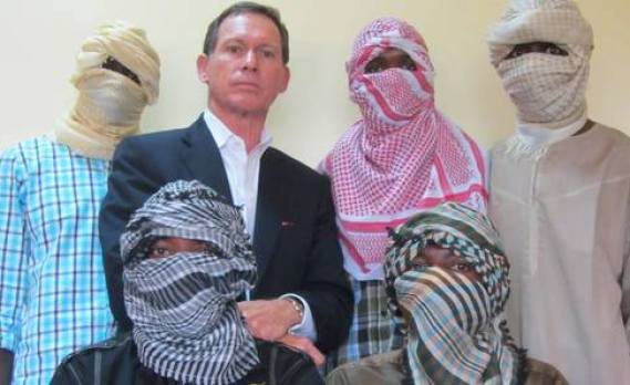 Stephen Davis, with some masked 'Boko Haram members'