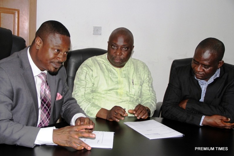 From Left: Managing Director, The Quadrant Company, Bolaji Okusaga; Publisher, Premium Times, Dapo Olorunyomi; and Editor-in-Chief, Premium Times, Musikilu Mojeed, signing a partnership agreement in Lagos, October 27, 2014