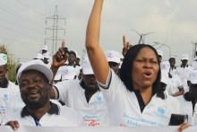 Joe Okei-Odumakin, President of Women Arise for Change Initiative, leading a protest against rape