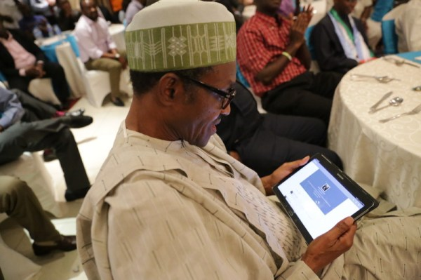 Buhari stares at his tablet pc