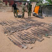 Assorted rifles discovered by troops in the suburb of Bama