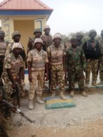 Troops in a group photograph in Police Training College Gwoza after the capture of the town from terrorists