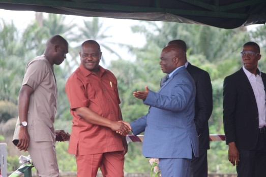 Rivers State Governor, Nyesom Ezenwo Wike (left) being introduced to members of the Lord's Chosen Charismatic Revival Mission Church by the General Overseer, Pastor Mouka Lazarus, during their church programme held in Port Harcourt.