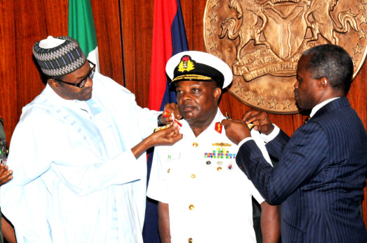 President Muhammadu Buhari (L)  Aided By Vice-President Yemi Osinbajo  In Decorating The Chief Of Naval  Staff, Ibok Ete Ekwe  Ibas  With His New Rank Of Vice-Admiral, At The Presidential Villa In Abuja On Thursday (13/8/15) | NAN