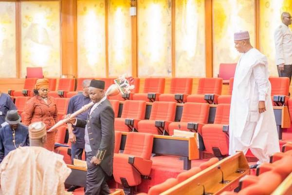 FILE PHOTO: Most seats empty as Senate President Bukola Saraki enters the chamber