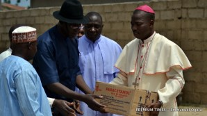 Bishop Stephen Mamza handing in medical supplies to health workers in Michika