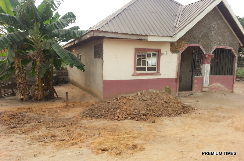 A victim, Emeka, was burried in a grave in front of his  house
