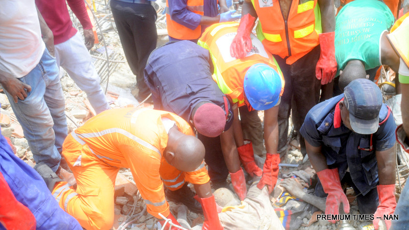 ONE OF THE TRAPPED VICTIMS BEING PULLED OUT BY THE RESCUE OFFICERS OF THE NATIONAL EMERGENCY MANAGEMENT AGENCY, AT THE COLLAPSED FIVE  STOREY BUILDING IN LEKKI GARDEN, IKATE ELEGUSHI, AT LEKKI IN LAGOS ON TUESDAY(8/03/16) 2170/8/03/2016/OOA/HF/CH/NAN