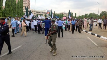 Protesters marching towards the National Assembly