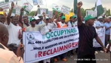 "OccupyNASS protesters protesting against an alleged denigration of the legislative arm by ""fraudulent individuals"""