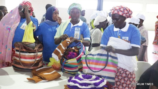 Women IDPs displaying crafts they made while undergoing financial literacy classes sponsored by UNHCR at AUN