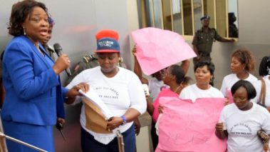 Representing Lagos State Governor, Commissioner for Women Affairs & Poverty Alleviation (WAPA), Hon. Lola Akande (left), receiving a letter from the Leader, Concern Group, Mrs. Aniko Adekanye (2nd left) during a protest by the group over the verbal attack by Senator Dino Melaye on Senator Oluremi Tinubu to the Governor's Office at the Lagos House, Ikeja, on Monday, July 18, 2016.