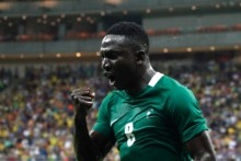 Nigeria's player Oghenekaro Etebo (8) celebrates the team's third goal against Japan during the Rio 2016 Olympic Games men's First Round Group B football match Nigeria vs Japan, at the Amazonia Arena in Manaus on August 4, 2016. / AFP PHOTO / RAPHAEL ALVES