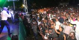 Governor Adams Oshiomhole sings to the admiration of the audience at the Victory party.
